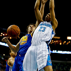 Mar 18, 2013; New Orleans, LA, USA; New Orleans Hornets power forward Anthony Davis (23) dunks over Golden State Warriors center Andrew Bogut (12) during the first quarter a game at the New Orleans Arena Mandatory Credit: Derick E. Hingle-USA TODAY Sports