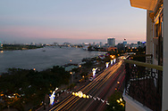 A constant stream of traffic outside the Majestic hotel along the Saigon River in Ho Chi MInh City, Vietnam, Southeast Asia