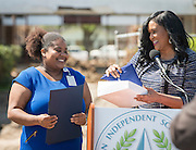 Shawn Thierry presents a flag to Kristy Love during a groundbreaking ceremony at Codwell Elementary School, March 3, 2017.