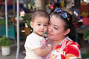 Uzbekistan, Tashkent. Chorsu Bazaar. Mother with child.