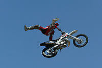 Jul 01, 2003; Anaheim, California, USA; Moto X star athlete CHUCK CAROTHERS executing a tremendous splits feet free with a full sized motobike at the opening of Disney's California Adventure &quot;X Games Experience&quot;.  Disney park has built two X-Arena's specifically for this 41 day event highlighting extreme sports for the launch of the 2003 ESPN X Games.<br />