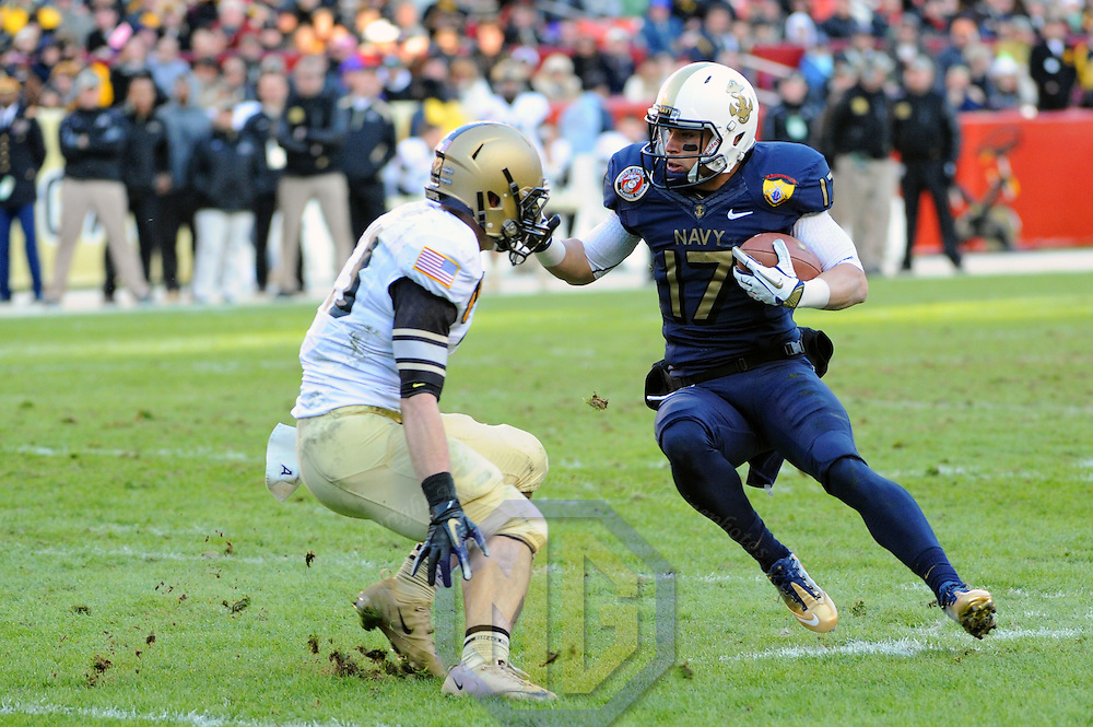10 December 2011:   Navy Midshipmen running back Mike Stukel (17) in action against Army Black Knights defensive back Thomas Holloway (23) at Fed Ex field in Landover, Md. in the 112th annual Army Navy game where Navy defeated Army, 27-21 for the 10th consecutive time.