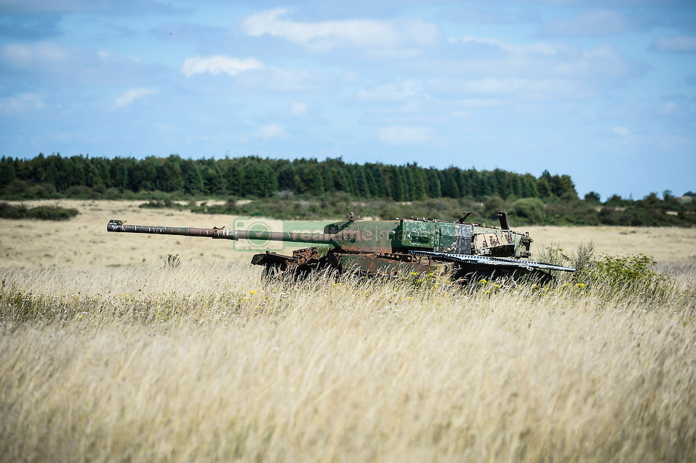 A disused tank that is used for target practice on Salisbury Plain in Wiltshire, as roads through Imber Village are now open and will close again on Monday August 22.