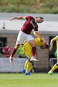 Northampton Town midfielder John-Joe O'Toole (21) jumps AFC Wimbledon midfielder Dannie Bulman (4) during the EFL Sky Bet League 1 match between Northampton Town and AFC Wimbledon at Sixfields Stadium, Northampton, England on 20 August 2016. Photo by Stuart Butcher.