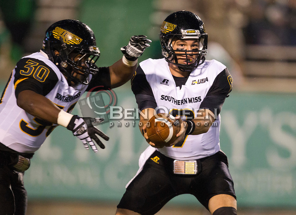 Oct 9, 2015; Huntington, WV, USA; Southern Miss Golden Eagles quarterback Nick Mullens (9) hands the ball off to Southern Miss Golden Eagles running back Jalen Richard (30) during the first quarter against the Marshall Thundering Herd at Joan C. Edwards Stadium. Mandatory Credit: Ben Queen-USA TODAY Sports