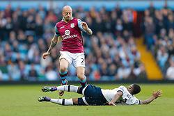 Alan Hutton of Aston Villa is tackled by Danny Rose of Tottenham Hotspur - Mandatory byline: Rogan Thomson/JMP - 13/03/2016 - FOOTBALL - Villa Park Stadium - Birmingham, England - Aston Villa v Tottenham Hotspur - Barclays Premier League.