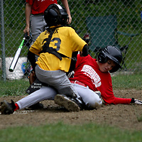 Erik Ferraro of the Lunberg Gustafson Astro's slides under the tag of the Kia Pirates Ben Burk at Michael LaGrega Memorial Park 6-18 photo by Mark L. Anderson