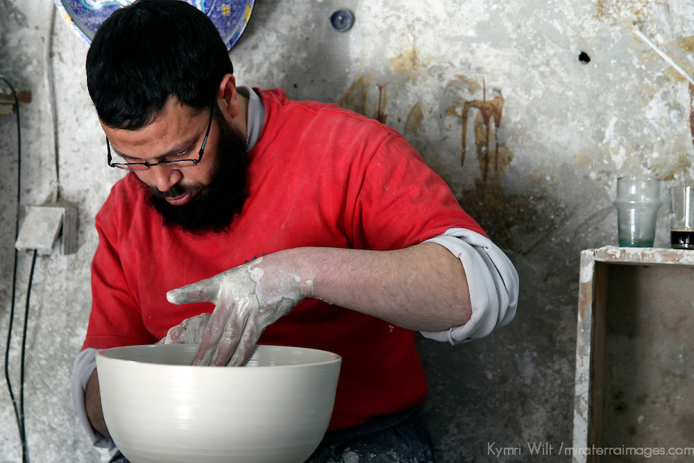 Africa, Morocco, Fes. Moroccan Potter spinning clay bowl.