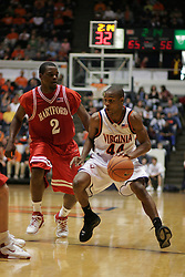 Sean Singletary (44) attacks the Hartford defense in the first half.  Singletary's 22 points lead the Hoos to a 71-62 victory at University Hall...The Virginia Cavaliers defeated the Hartford Hawks 71-62 at University Hall in Charlottesville, VA on December 31, 2005.