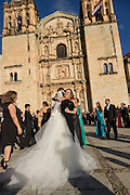 A bride embraces her wedding party outside the Santo Domingo Church October 257, 2014 in Oaxaca, Mexico.