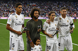 September 29, 2018 - Madrid, Madrid, Spain - Varane(Real Madrid) Marcelo (Real Madrid) Modric (Real Madrid) and Sergio Ramos(Real Madrid) poses with tophys before the La Liga match between Real Madrid and Club Atletico de Madrid at Estadio Santiago Bernabéu in Madrid, Spain. (Credit Image: © Manu Reino/SOPA Images via ZUMA Wire)