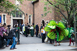 London, UK. 14th June, 2018. A large green Grenfell flower arrives for the Grenfell Memorial Service at St Helen's Church.