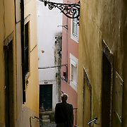 A man in the old streets of the Alfama in Lisbon