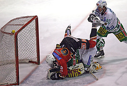 Andrej Hebar of Jesenice crashed on goalkeeper Klemen Mohoric at ice hockey match Acroni Jesencie vs ZM Olimpija in second round of final of Slovenian National Championship,  on April 5, 2008 in Arena Podmezaklja, Jesenice, Slovenia. Acroni Jesenice won the game 6:1 and lead the series 2:0.  (Photo by Vid Ponikvar / Sportal Images)