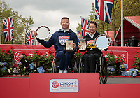 The presentations for the elite Wheelchair race winners David Weir GBR and Manuela Schar SUI. The Virgin Money London Marathon, 23rd April 2017.<br /> <br /> Photo: Ben Queenborough for Virgin Money London Marathon<br /> <br /> For further information: media@londonmarathonevents.co.uk