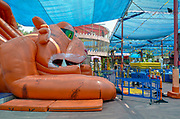 An inflatable jump house in a children's play are