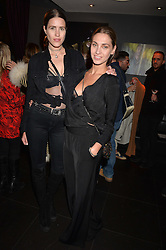 Left to right, Katie Alexander-Thom and Colette Gibson at an exhibition of photographs by Erica Bergsmeds held at The Den, 100 Wardour Street, London England. 19 January 2017.