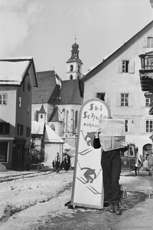 Newspaper Reader Leaning on School Sign, Kitzbühel, Austria, 1935