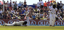 November 7, 2018 - Galle, Sri Lanka - Sri Lankan cricketer Niroshan Dickwella looks on as England cricketer Rory Burns (L) lies down after being hit during the 2nd day's play of the first test cricket match between Sri Lanka and England at Galle International cricket stadium, Galle, Sri Lanka. 11-07-2018  (Credit Image: © Tharaka Basnayaka/NurPhoto via ZUMA Press)