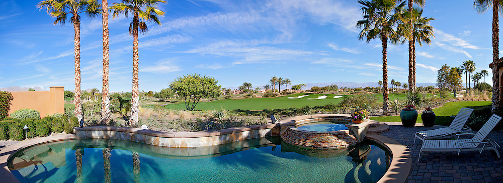 Panoramic view of swimming pool, hot tub and golf course.