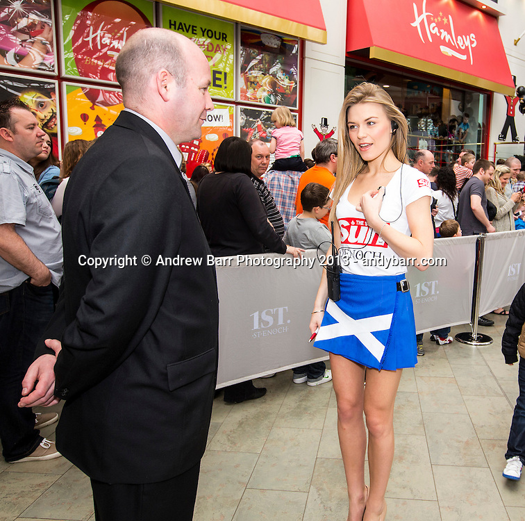 05:05:2013..Miss Scotland 2013 -  The girls get working behind the scenes at the St. Enoch Centre...Emily works security at Hamleys with Kevin..Pic:Andy Barr..07974 923919  (mobile).andy_snap@mac.com..All pictures copyright Andrew Barr Photography. ..Please contact before any syndication. .