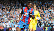 Wilfred Zaha chases down the loose ball during the Barclays Premier League match between Crystal Palace and Manchester City at Selhurst Park, London, England on 12 September 2015. Photo by Michael Hulf.