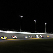 The field is seen in turn four of the NASCAR Sprint Unlimited Race at Daytona International Speedway on Saturday, February 16, 2013 in Daytona Beach, Florida.  (AP Photo/Alex Menendez)