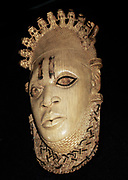 Carved ivory mask, Benin, Nigeria.  Edo peoples, c 16th century AD.  The palace of Benin is the centre of ritual activity focused on the well-being and prosperity of the Edo peoples.  Each year the Edo (King) of Benin takes part in rituals in which he honours his royal ancestors to enhance the good fortunes of his people.