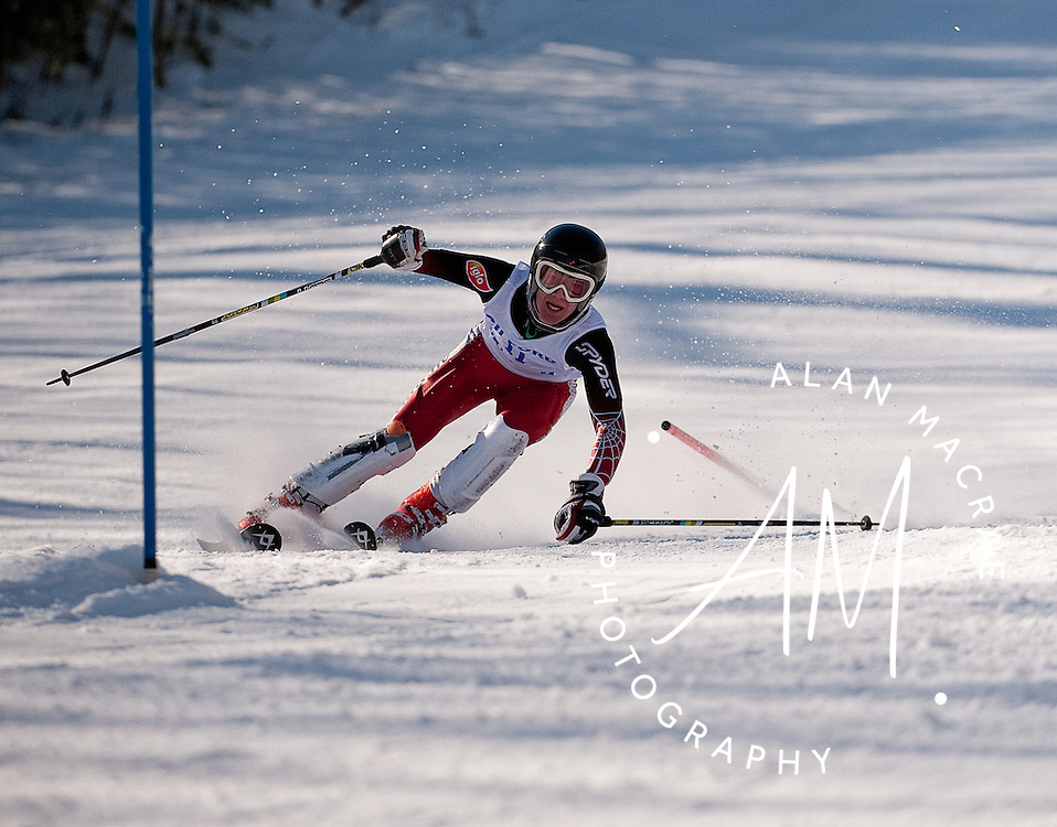 Gilford's Michael Workman makes his way through a gate in the slalom run during the NHIAA Division III Championship at Gunstock on Tuesday, February 9, 2010.  (Alan MacRae/for the Citizen)
