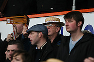 Picture by David Horn/Focus Images Ltd +44 7545 970036.16/02/2013.A Luton Town fan holds his rattle aloft during the game against Millwall in the The FA Cup match at Kenilworth Road, Luton.
