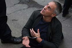 London, UK. 16 October, 2019. Metropolitan Police officers arrest Jonathan Bartley, co-leader of the Green Party, under Section 14 of the Public Order Act 1986 after he, Guardian journalist George Monbiot and a group of climate activists from Extinction Rebellion sat in the road in Whitehall following a People's Assembly in Trafalgar Square as part of a protest against the use by the Metropolitan Police of Section 14 so as to prohibit entirely Extinction Rebellion Autumn Uprising protests throughout the capital.