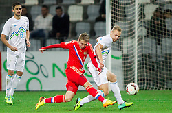 Dmitry Efremov of Russia vs Zan Benedicic of Slovenia during football match between U21 National Teams of Slovenia and Russia in 6th Round of U21 Euro 2015 Qualifications on November 15, 2013 in Stadium Bonifika, Koper, Slovenia. Russia defeated Slovenia 1-0. Photo by Vid Ponikvar / Sportida