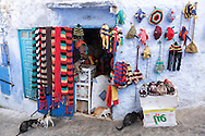 Knitwear displayed outside a small shop in the medina of Chefchaouen, Morocco.