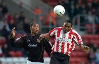 Photo: Alan Crowhurst.<br />Southampton v Milton Keynes Dons. The FA Cup.<br />07/01/2006. <br />Clive Platt (L) challenges Saints' Darren Kenton.