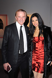 GEOFFREY KENT and OTAVIA KENT at the Krug Mindshare auction held at Sotheby's, New Bond Street, London on 1st November 2010.