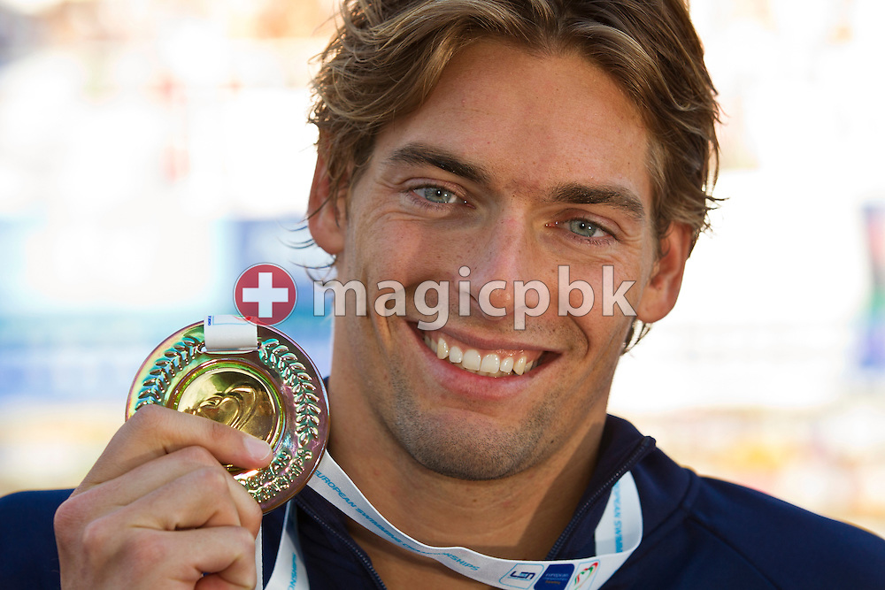 Camille LACOURT of France poses with his gold medal after winning in a new European Record time the men's 100m Backstroke Final at the European Swimming Championship at the Hajos Alfred Swimming complex in Budapest, Hungary, Tuesday, Aug. 10, 2010. (Photo by Patrick B. Kraemer / MAGICPBK)
