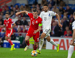 CARDIFF, WALES - Friday, September 6, 2019: Wales' captain Gareth Bale gets away from Azerbaijan's Dmitri Nazarov during the UEFA Euro 2020 Qualifying Group E match between Wales and Azerbaijan at the Cardiff City Stadium. (Pic by Mark Hawkins/Propaganda)