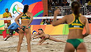 RIO DE JANEIRO, Aug. 17, 2016  <br /> <br /> Bums on show at the Volleyball at Olympics<br /> <br /> OLYMPICS BEACH VOLLEYBALL: Kerri Walsh Jennings (USA) dives for serve by Agatha Rippel Bednarczuk (BRA) and Barbara Seixas de Freitas (BRA) in the semifinals at Beach Volleyball Arena during the 2016 Rio Summer Olympics games. <br /> ©Exclusivepix Media