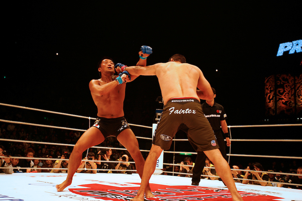 American Fighter Dan  Henderson fights Kazuo Misaki  japan..BUSHIDO Extreme Martial Art fighting Rules are quite limited and fights usually carry on past the bloody nose stage.  It's  very popular in Japan, goes out on primetime TV, fighters get paid as much as 4 million US Dollars a fight and are seen as celebs. Crowd consist of young families, couples etc. Piece will look at why sport is so successful in Japan, appealing to so called 'lost generation' of young people suffering from effects of collapse of economy/rise of unemployment.