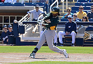 PHOENIX, AZ - FEBRUARY 23:  Jemile Weeks #19 of the Oakland Athletics hits a double in the spring training game against the Milwaukee Brewers at Maryvale Baseball Park on February 23, 2013 in Phoenix, Arizona.  (Photo by Jennifer Stewart/Getty Images) *** Local Caption *** Jemile Weeks