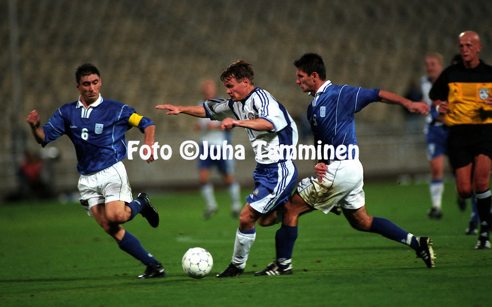 07.10.2000, Olympic Stadium, Athens, Greece. .FIFA World Cup Qualifying match, Greece v Finland. Joonas Kolkka (Finland) v Theodoros Zagorakis (6) &  Marinos Ouzonidis (Greece).©JUHA TAMMINEN