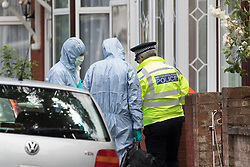 © Licensed to London News Pictures. 05/06/2017. LONDON, UK.  Forensic officers with police at a residential house in Caledon Road in Newham.  Police are believed to have carried out a raid at an address in Caledon Road this morning in connection with the London Bridge terror attacks. Photo credit: Vickie Flores/LNP
