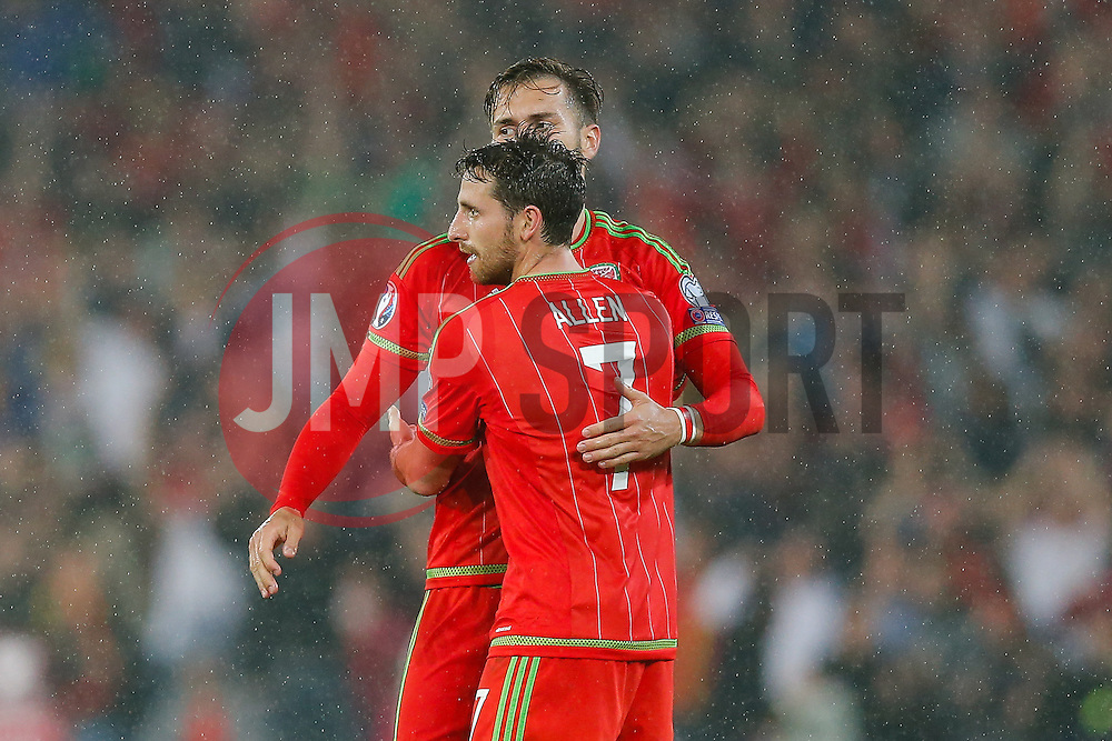 Aaron Ramsey (Arsenal) and Joe Allen (Liverpool) celebrates after Wales win the match 1-0 to top their UEFA2016 Qualifying Group - Photo mandatory by-line: Rogan Thomson/JMP - 07966 386802 - 12/06/2015 - SPORT - FOOTBALL - Cardiff, Wales - Cardiff City Stadium - Wales v Belgium - EURO 2016 Qualifier.