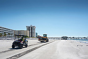 Redington Beach, Pinellas County,  Florida, USA., Monday, 15th October, 2018, Beach Replenishment, JOHN DEERE 664K, Wheel Loader, carrying a Generator in the Bucket, with a buggy escort,