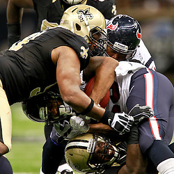 August 25, 2012; New Orleans, LA, USA; Houston Texans running back Arian Foster (23) is tackled by a group of New Orleans Saints defenders during the first half of a preseason game at the Mercedes-Benz Superdome. Mandatory Credit: Derick E. Hingle-US PRESSWIRE