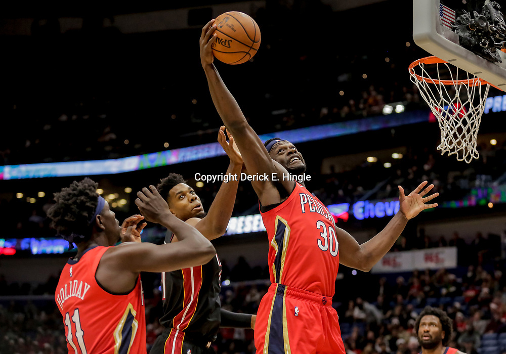 Dec 16, 2018; New Orleans, LA, USA; New Orleans Pelicans forward Julius Randle (30) rebounds over Miami Heat center Hassan Whiteside (21) during the first half at the Smoothie King Center. Mandatory Credit: Derick E. Hingle-USA TODAY Sports
