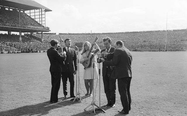 "The ""Charioteers"" Brendan O'Duill, Sean Potts singing at the All Ireland Minor Gaelic Football Final Sligo v. Cork in Croke Park on the 22nd September 1968. Cork 3-5, Sligo 1-10."