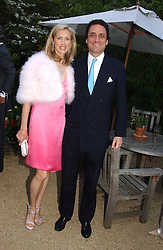 COUNT & COUNTESS ALLESANDRO GUERRINI-MARALDI  at the annual Cartier Flower Show Diner held at The Physics Garden, Chelsea, London on 23rd May 2005.<br />