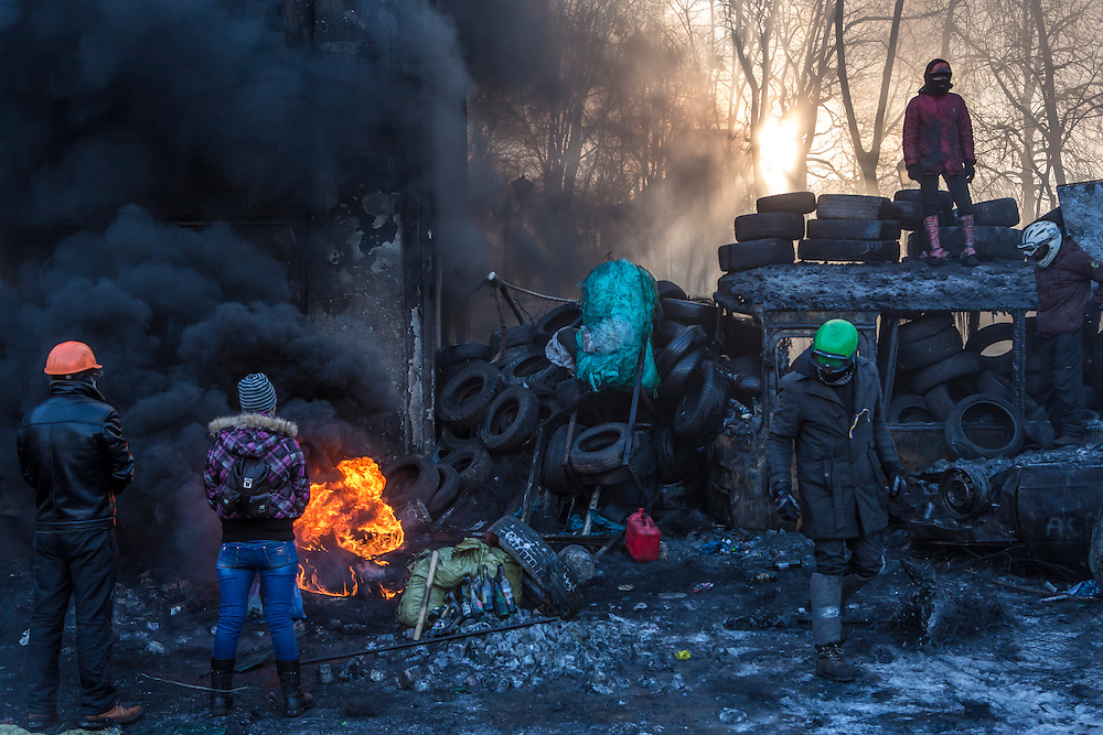 KIEV, UKRAINE - JANUARY 24: Anti-government protesters set fire to tires near Dynamo Stadium on January 24, 2014 in Kiev, Ukraine. After two months of primarily peaceful anti-government protests in the city center, new laws meant to end the protest movement have sparked violent clashes in recent days. (Photo by Brendan Hoffman/Getty Images) *** Local Caption ***