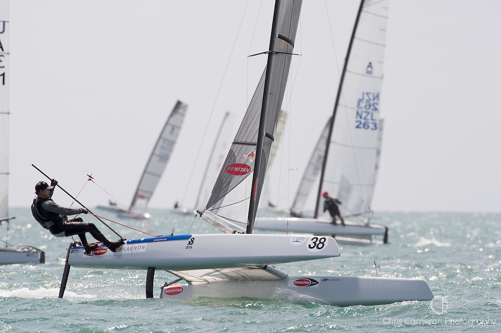 Glenn Ashby (AUS111) rounds the top mark in race three of the A Class World championships regatta being sailed at Takapuna in Auckland. 12/2/2014
